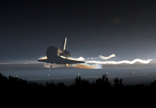 Space shuttle Atlantis (STS-135) touches down at NASA's Kennedy Space Center Shuttle Landing Facility (SLF), completing its 13-day mission to the International Space Station (ISS) and the final flight of the Space Shuttle Program, early Thursday morning, July 21, 2011, in Cape Canaveral, Fla. Overall, Atlantis spent 307 days in space and traveled nearly 126 million miles during its 33 flights. Atlantis, the fourth orbiter built, launched on its first mission on Oct. 3, 1985. Photo Credit: (NASA/Bill Ingalls)
